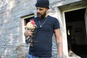 Abz on the Farm - holding Fernando the cockerel. C) Tin Can Island